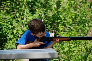 Chase shooting my old Red Ryder - first time for him to shoot a BB gun.